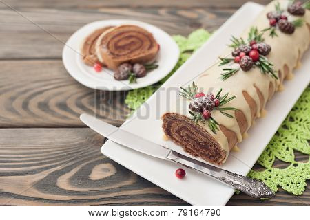 Christmas sponge roll on wooden background