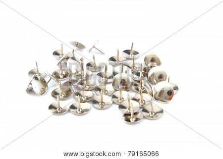 Thumbtacks on a white background