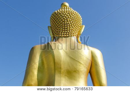Back Side Of Golden Buddha With Deep Blue Sky Background