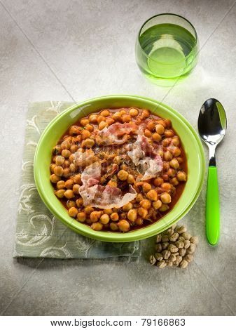 chickpeas soup with bacon and tomato sauce