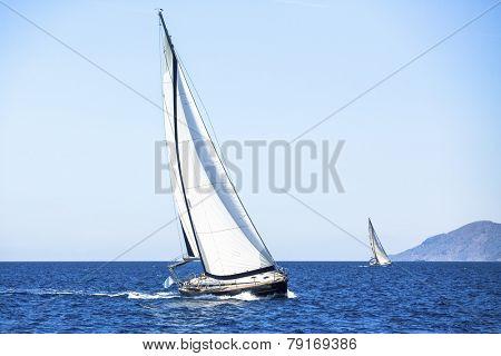 Sail yachts in regatta in open the Sea. Sailing regatta. Luxury yachts.
