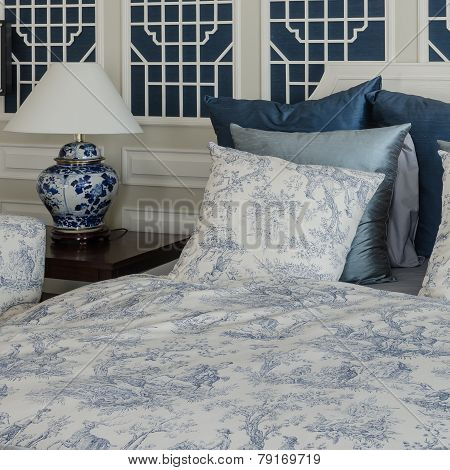 Pillows On Luxury King Size Bed With Lamp