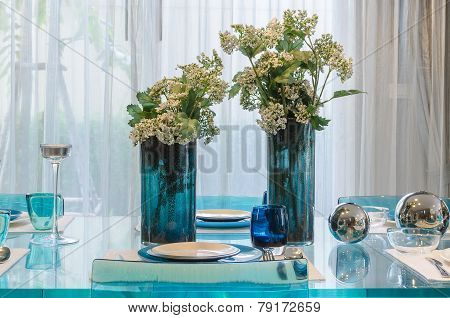 Vase Of Flower On Glass Dinning Table