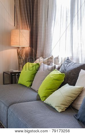 Grey Sofa With Green Pillows In Living Room