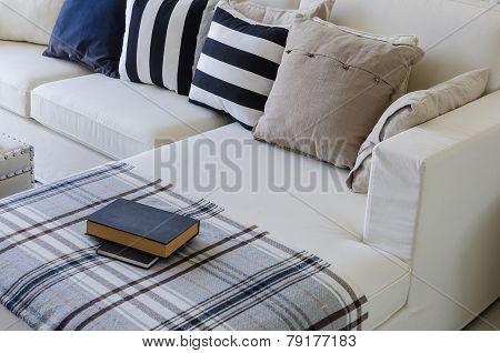 Large White Sofa With Pillows And Book In Living Room