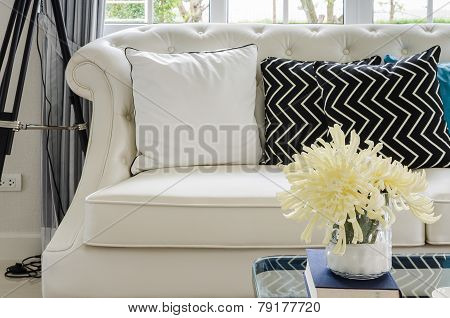 Luxury White Sofa In Living Room With Yellow Flower In Vase