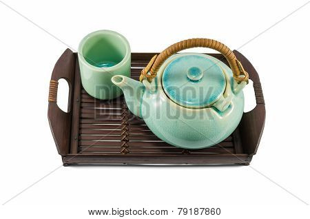 Chinese Green Teapot And Teacups On The Wooden Trivet Isolated