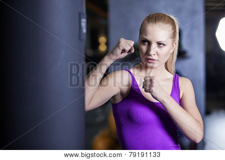 Strong boxing woman exercise in a gym