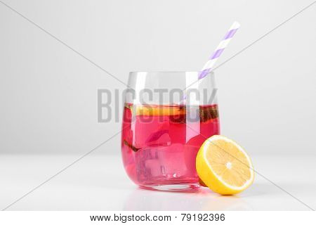Pink lemonade in glass isolated on white