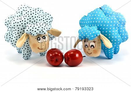 Two rag-dolls speckled lambs with apples