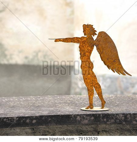 Young man with wings made of metal