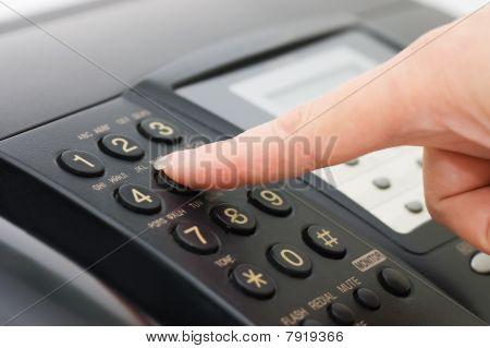 The Hand Presses The Fax Button