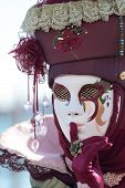 image of hush  - A masked lady hushing exhibited during the traditional festival of Carnival of Venice Italy  - JPG