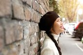image of beret  - Close up portrait of a happy young woman standing outside with beret - JPG