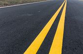 stock photo of paved road  - Asphalt road with pair of yellow line - JPG