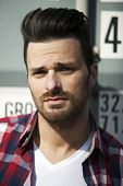 pic of funky  - Hansome man in striped shirt and t shirt with beard and funky haircut - JPG