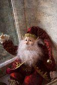 picture of long beard  - Christmas elf figure sitting in window with long white beard - JPG
