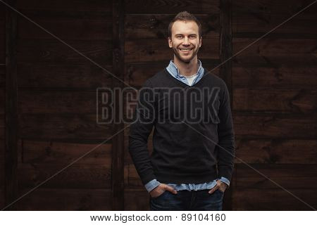 young handsome man over wooden background