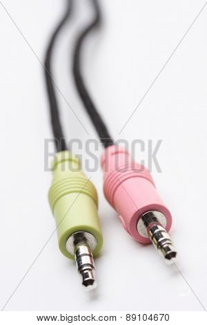 Audio cables on white background