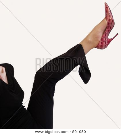 Young Woman Kicking Leg With High Heel Shoe
