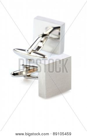 Silver cuff links on white background