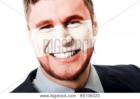Happy man with Austria flag painted on face.