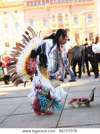CHERNOVTSY, UKRAINE, October 22, 2010: Peruvian street musician singing and dancing