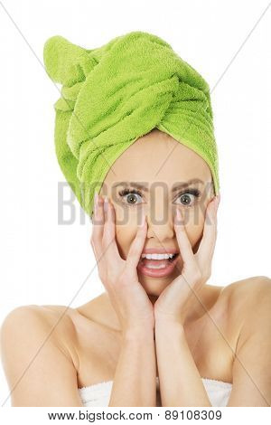 Shocked woman with towel wrapped on head.