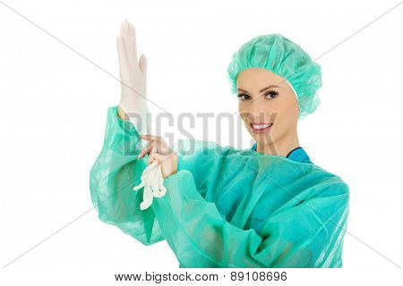 Doctor putting sterilized medical glove for operation.