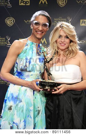 BURBANK - APR 26: Carla Hall, Daphne Oz at the 42nd Daytime Emmy Awards Gala at Warner Bros. Studio on April 26, 2015 in Burbank, California