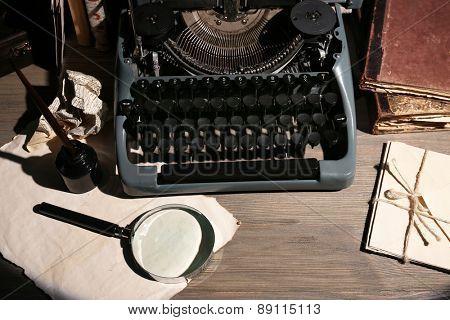 Retro typewriter on wooden table, closeup