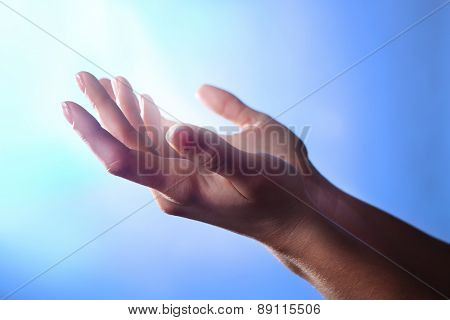 Woman praying on bright background