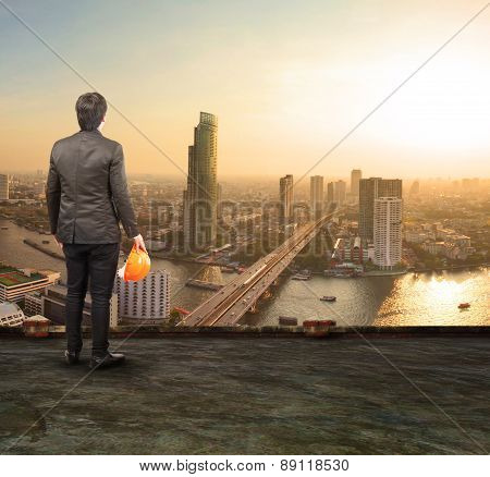 Engineering Man Standing On Top Of Building Looking To Urban Scene Dreaming To New Project