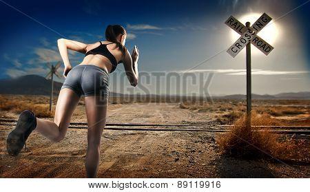 Girl Athlete Running On The Road