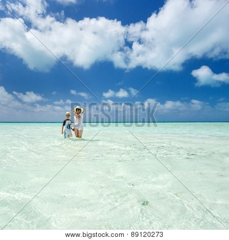 Woman, boy and Caribbean sea