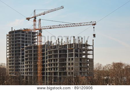 Image of building under construction and cranes