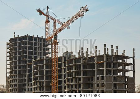 Building construction site with cranes under sky