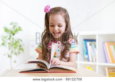 little student girl studying at preschool