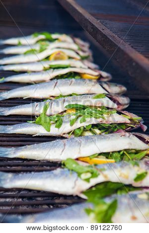 stuffed sea bass  fish grilling on BBQ
