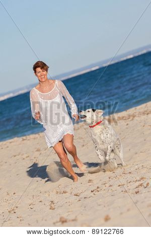 fit healthy woman running with pet dog
