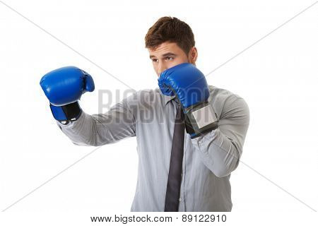 Young businessman with boxing gloves.
