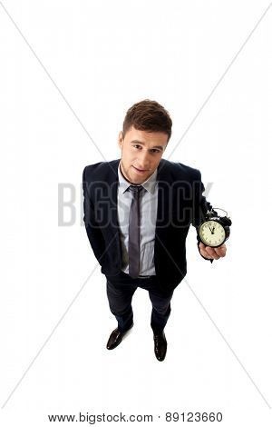 Handsome businessman with alarm clock.