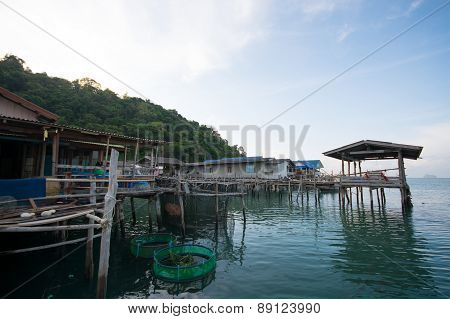 An Image Of Fisherman Village In The Sea