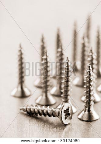 screws tool at metal background texture