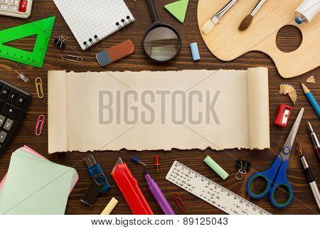 school supplies on wooden background