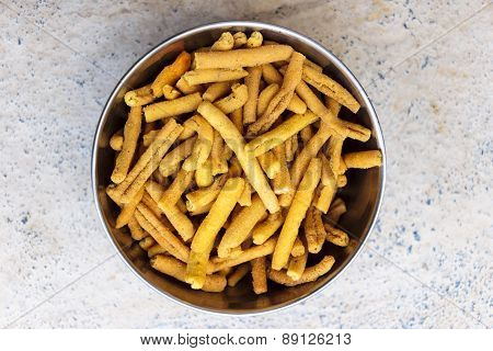 Indian Savoury made from fried paste of gram flour, rice powder will all masala ingredients