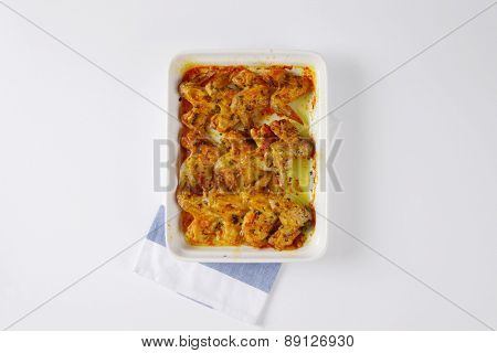 overhead view of chicken wings baked with marinade and served in the porcelain tray
