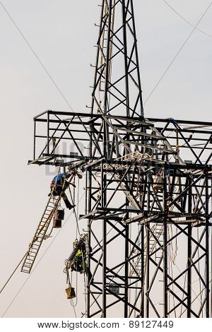 construction of a new high-voltage line. workers on electricity pylons