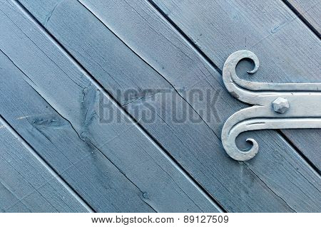 decorated fitting of wooden door, a symbol of connection, blacksmithing, background