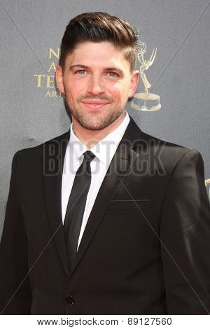 LOS ANGELES - APR 26:  Robert Adamson at the 2015 Daytime Emmy Awards at the Warner Brothers Studio Lot on April 26, 2015 in Burbank, CA